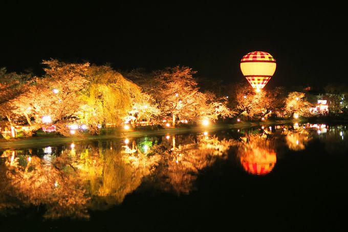 桜が池に映り込んで倍楽しい!長野県須坂市「臥竜公園」夜には熱気球体験も!